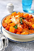 Roasted chicken legs with pumpkin and carrot