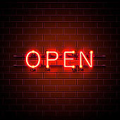 Neon sign with text open, entrance is available.