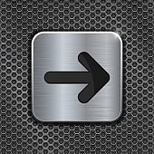 Metal button with arrow on iron perforated background