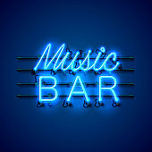 Neon music bar signboard on the blue background.