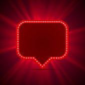 Neon frame sign in the shape of a chat.