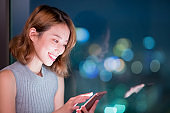 woman use phone happily
