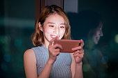 woman play mobile game