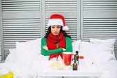 Sick on New Year! Sad ill woman in santa hat