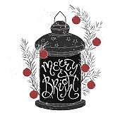 Christmas brush lettering placed in a form of a decorated holiday lantern and saying Merry and bright.