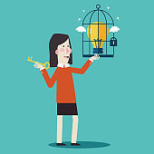 Business woman with golden key help unlock idea bulb from a cage. Business idea, development and strategy concept. New business project start up concept