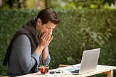 Businessman suffering from cold and flu