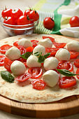 Emilian piadina with tomato, mozzarella and basil - closeup
