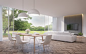 Modern dining and living room with garden view 3d rendering image