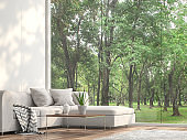 Minimal sofa located at the window with garden view 3d render