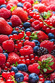 Berries fresh colorful assortment strawberries blackberries red currant raspberries arrangement