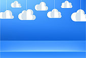 Blue background with white paper 3d decorative clouds.
