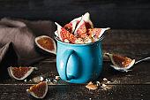 Healthy breakfast figs natural yoghurt almonds Rustic style