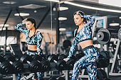Woman exercise workout in gym fitness breaking relax holding dumbbell, healthy lifestyle bodybuilding, Athlete builder muscles lifestyle.