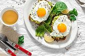 Top view healthy avocado toasts breakfast lunch fried eggs cup tea healthy breakfast