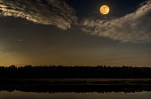 Night sky and full moon at seaboard. Serenity nature background.