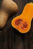 Still life of  Butternut Squash on dark wooden background
