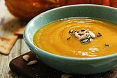 Homemade Thick and Creamy Pumpkin Soup, close up selective focus