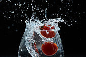 tomato falls into the water
