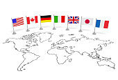 G7 summit (economic political concept). Flags of seven member countries on the world map. Usa, Canada, Germany, Italy, Great Britain, Japan, France as partners of meeting