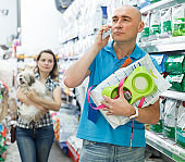 male with purchases talking on phone