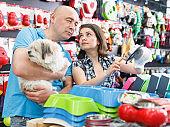 Couple purchasing pet bowls in pet shop