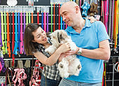 Couple with dog in pet shop