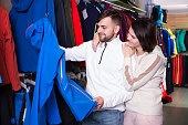 couple choosing  ski clothes