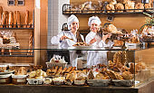 Friendly women at bakery display