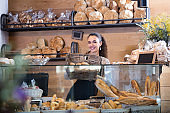 young woman at bakery display