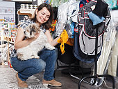 woman choosing for clothes for dog