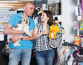 customers with dog choosing comfortable  clothes