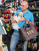 customer with dog looking new goods