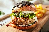 Crispy burger served on wooden board