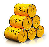 Group of stacked yellow drums with radioactive waste isolated on white
