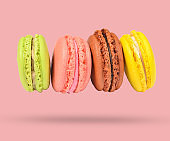 Minimalism concept. Horizontal Stack of colored pastel cookies macaroons on pink background