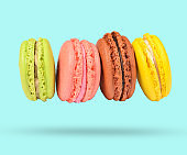 Minimalism concept.Horizontal Stack of colored pastel cookies macaroons on blue background.