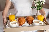 Woman holding a breakfast