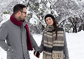 Young couple walking on snow