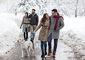 Friends walking in park on snow