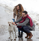 Couple with dog on snow