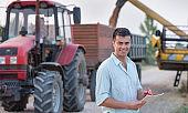 Farmer with notebook at wheat harvest