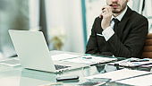successful businessman working with financial documents at Desk
