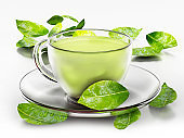 Green tea cup and fresh leaves isolated on white