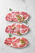 Fresh cut pork or beef meat isolated on a marble background viewed from above. Uncooked high protein red meat. Top view