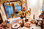 friends celebrate the new year at home