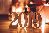 christmas present on parquet floor for the new year 2019