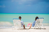 Couple relax on a tropical beach