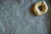 Bagel prepared for baking on baking paper