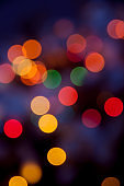 Festive abstract  art. Christmas Tree lights and decoration bokeh blurred out of focus background.